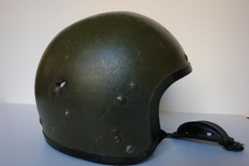 Зашитный шлем Сфера выпускникна НВИ  капитана Василия Паукова, пробитый снайпером боевиков во время спецоперации близь села Цветково, Дагестан, 10 мая 2012 года